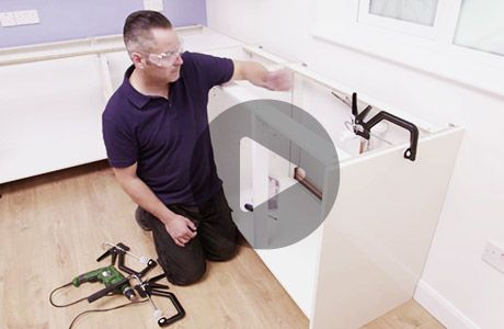 How To Install Lower Kitchen Cabinets install kitchen base cabinets | how to videos