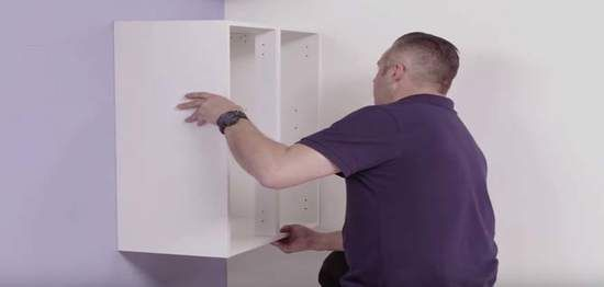 step 7 of installing a kitchen wall cabinet