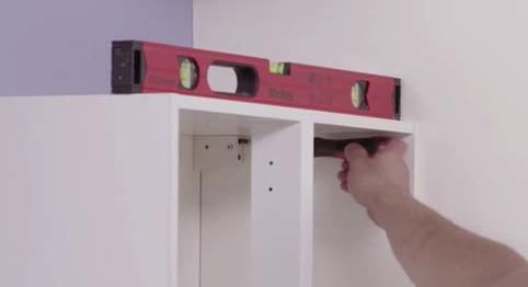 step 8 of installing a kitchen wall cabinet