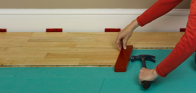How to lay real solid wood flooring for Wood floor knocking block